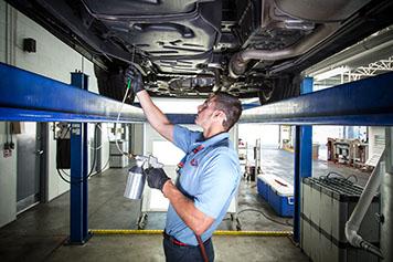 Delta Sonic Employee Applying Rustproofing